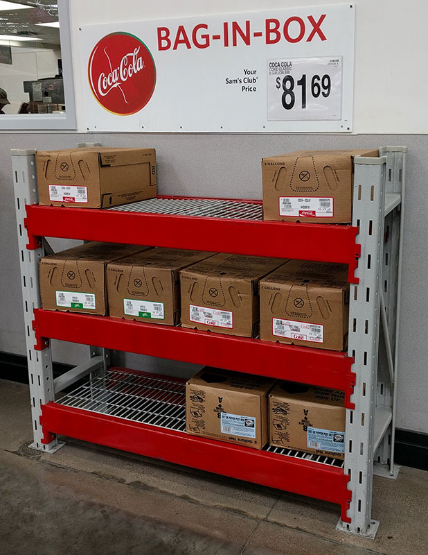 Rack of bag-in-box Coke syrups at our local Sam's Club