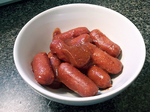 Homemade BBQ sauce on lil smokies