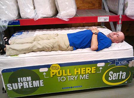 Scott testing a mattress at Sam's Club