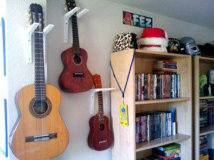 ukuleles hanging on the wall