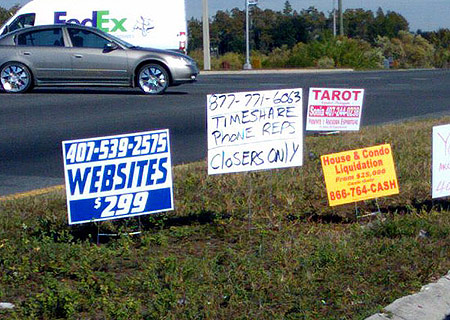 Random ad signs by the road